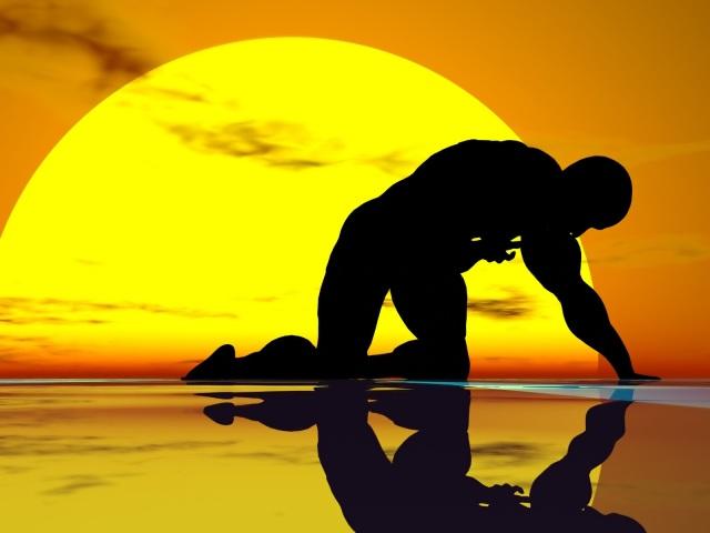 fallen-man-silhouette-and-sun